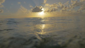 Viewing sunset from the sea water surface stock footage