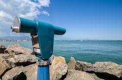 Viewing telescope monocular overlooking Lake Garda in Lombardy, Italy. Garda is Italy`s largest lake and a popular destination for locals and tourists alike royalty free stock photo