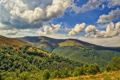 Viewn on the mountains and cumulus clouds. Carpathians Royalty Free Stock Image