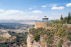 Viewpoint with gargoyle. Mountainside in the Spanish town of Ronda in the province of Malaga. skies are cloudy, and a landscape of viewpoint with gargoyle Royalty Free Stock Photos
