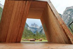 Three peaks view through a giant wooden frame in the Dolomites,. The viewpoint through a giant wooden frame to the Three Peaks or Tre Cime di Lavaredo is called Stock Photos