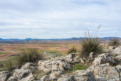 A viewpoint at the hill with a view to fields and mountains near Consuegra Castilla La Mancha Royalty Free Stock Photos