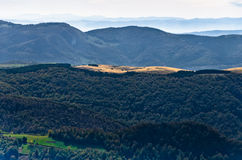 Viewpoint on a landscape of mount Bobija, peaks, hills, meadows and green forests Royalty Free Stock Image