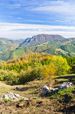 Viewpoint on a landscape of mount Bobija, peaks, hills, rocks, meadows and colorful forests Stock Photography