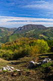 Viewpoint on a landscape of mount Bobija, peaks, hills, rocks, meadows and colorful forests Royalty Free Stock Photography