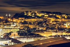 Viewpoint in Lisbon at night with a view of Castelo Sao Jorge stock photography