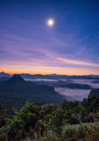 Viewpoint mist mountain colorful with the moon at dawn Royalty Free Stock Photography