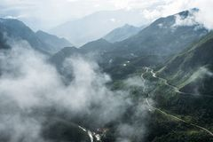 Viewpoint mountain range highest on fog in Tram Ton Pass. Sapa, Vietnam Royalty Free Stock Photography