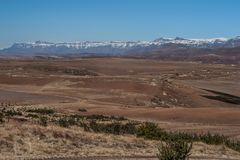 Viewpoint over Lesotho and snowcapped Maluti mountains. With winter landscape in the Stock Photo