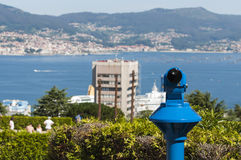 Viewpoint over Vigo, Spain. A telescope in focus looking over the port of Vigo with cruise ship in background Stock Image