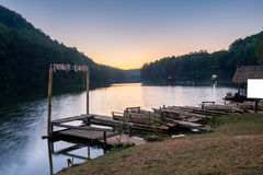 Viewpoint reservoir with raft floating at sunset Stock Photo