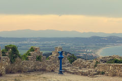 Viewpoint tool on a touristic medieval wall on a sunset coastal landscape. Stock Photography