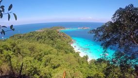Viewpoint View from Rocks on the Beach Filled with Toutists and Blue Water with Speedboats. Similan Island, Thailand. stock footage