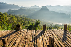 Viewpoint wood terrace with fog mountain Royalty Free Stock Image