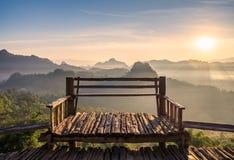 Viewpoint wood terrace with sunshine mountain at morning. Baan jabo,mae hong son,thailand Royalty Free Stock Photo