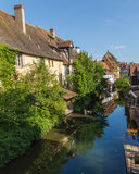 Views along River Lauch in Colmar. COLMAR, FRANCE - 30TH JULY 2016: Views along the River Lauch in Colmar in the morning Royalty Free Stock Photos