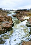 The Big Sioux River flows over rocks in Sioux Falls South Dakota with views of wildlife, ruins, park paths, train track bridge, tr. Views of the Big Sioux River Stock Photos