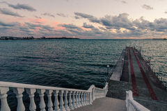 Views of the black sea and pier. View of the nnsea and pier with stairs to the waterfront Stock Photo