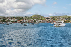 Views of boats and houses arriving at colorful Puerto Baquerizo Moreno Royalty Free Stock Photo