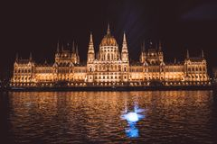Views of the budapest parliament from the danube river at night, hungary stock images