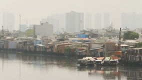 Views of the city`s slums from the river Stock Photo
