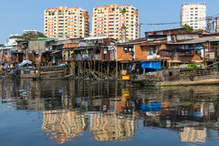 Views of the city's Slums from the river. Royalty Free Stock Photo