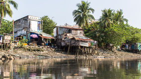 Views of the city's Slums from the river. Stock Image