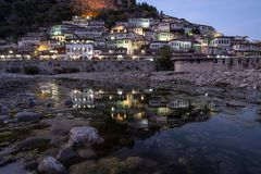 Berat lights on houses reflecting in river below stock images