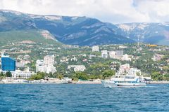 Views of the Crimean coastline with hotels and beaches with moun royalty free stock photo