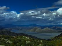 Different mountain shapes over Skadar lake stock image