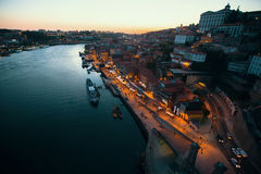 Views of Douro river and Ribeira from Dom Luis I Bridge at night time, Porto Royalty Free Stock Photos