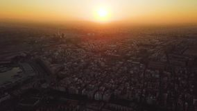 Views from drone during sunset on beach Malvarrosa in Valencia. City, bay and port view during golden hour in beautiful place stock video