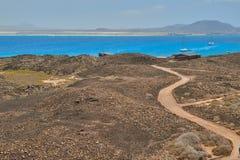 Wonderful views of blue sea with boats sailing in Isla de Lobos, Fuerteventura stock photo