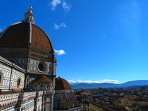 The views of florence. A roof top view of houses in the historic and beautiful city of florence. the il duomo's red dome  features in the foreground of picture Royalty Free Stock Images