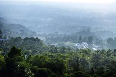 Views of the forest and farms from a high place. With the morning sun shining beautifully Stock Photography