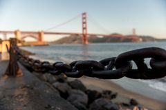 Views of the Golden Gate Bridge at sunrise from Fort Point, San Francisco, California, USA royalty free stock image