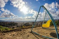 Views of Granada from a swing for children royalty free stock image