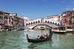 Views of the Grand canal, gondola with tourists and the Rialto bridge. Venice Stock Photography