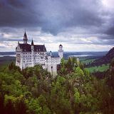Views from the Hike to Neuschwanstein Castle. The hike to Neuschwanstein Castle is a gorgeous one. This photograph shows Neuschwanstein Castle in dramatic stock images