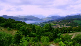 Views of the Italian countryside. View of a mountain landscape in the early morning, and forest with lots of green Royalty Free Stock Photo