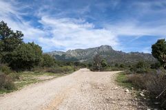 Views of the La Barranca Valley. In Guadarrama Mountains, Madrid, Spain. In the background, the peaks of La Maliciosa and Alto de Guarramillas (Bola del Mundo Stock Photography
