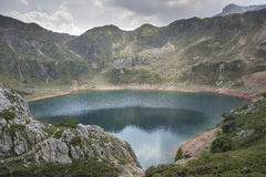 Views of Lago de la Cueva Lake of the Cave. In Saliencia Valley, Somiedo Nature Reserve. It is located in the central area of the Cantabrian Mountains in the Stock Image