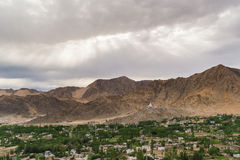 Views of Leh city from the top.Light and shade from sunset. Leh, a high-desert city in the Himalayas, is the capital of the Leh region in northern India's Stock Photo