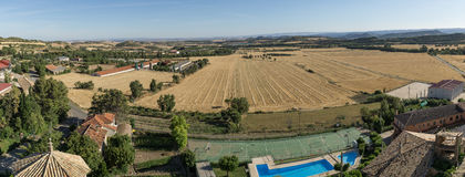 Views from Loarre Aragon Huesca Spain, wheat fields already harvested, municipal swimming pool, access road to the Royalty Free Stock Image