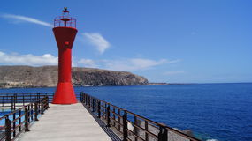 Views of Los Cristianos. Lighthouse on a pier in port of Los Cristianos Stock Photography