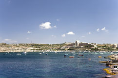 Malta, Coastline view. Salina Bay in the northwestern part of Malta with tourist facilities in the background - Bugibba, Malta Stock Images