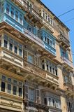 Malta, Streets of Valletta. Traditional wooden closed balconies on houses along the street in the Maltese capital city, Valletta, Malta Royalty Free Stock Image