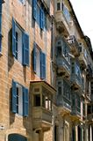Malta, Streets of Valletta. Traditional small wooden closed balconies on houses along the street in the Maltese capital city, Valletta, Malta Royalty Free Stock Photography