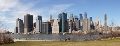 Views on Manhattan Skyline from Brooklyn Bridge Park in New York City. Royalty Free Stock Images