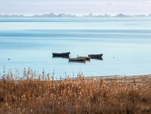 Views of the Mar Menor with some boats in the sea. And in the background La Manga. The photo is made from Los Urrutias Stock Photos